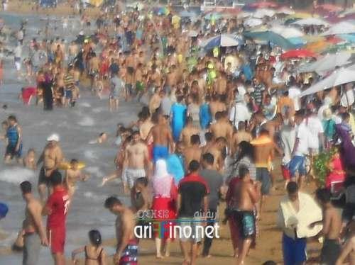 شاهد 50 صورة: :شاطئ أركمان يجذب آلاف العائلات الناظورية والهاربين من شمس المدينة الحارقة وصخبها